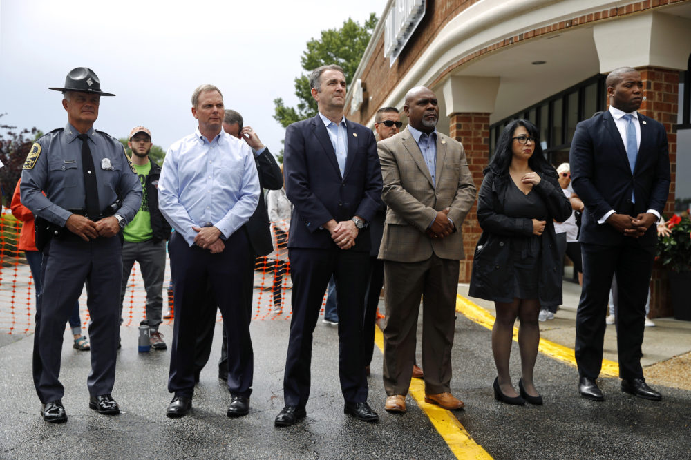 Virginia Gov. Ralph Northam, center, attends a vigil in response to a shooting at a municipal building in Virginia Beach, Va., Saturday, June 1, 2019. (Patrick Semansky/AP)