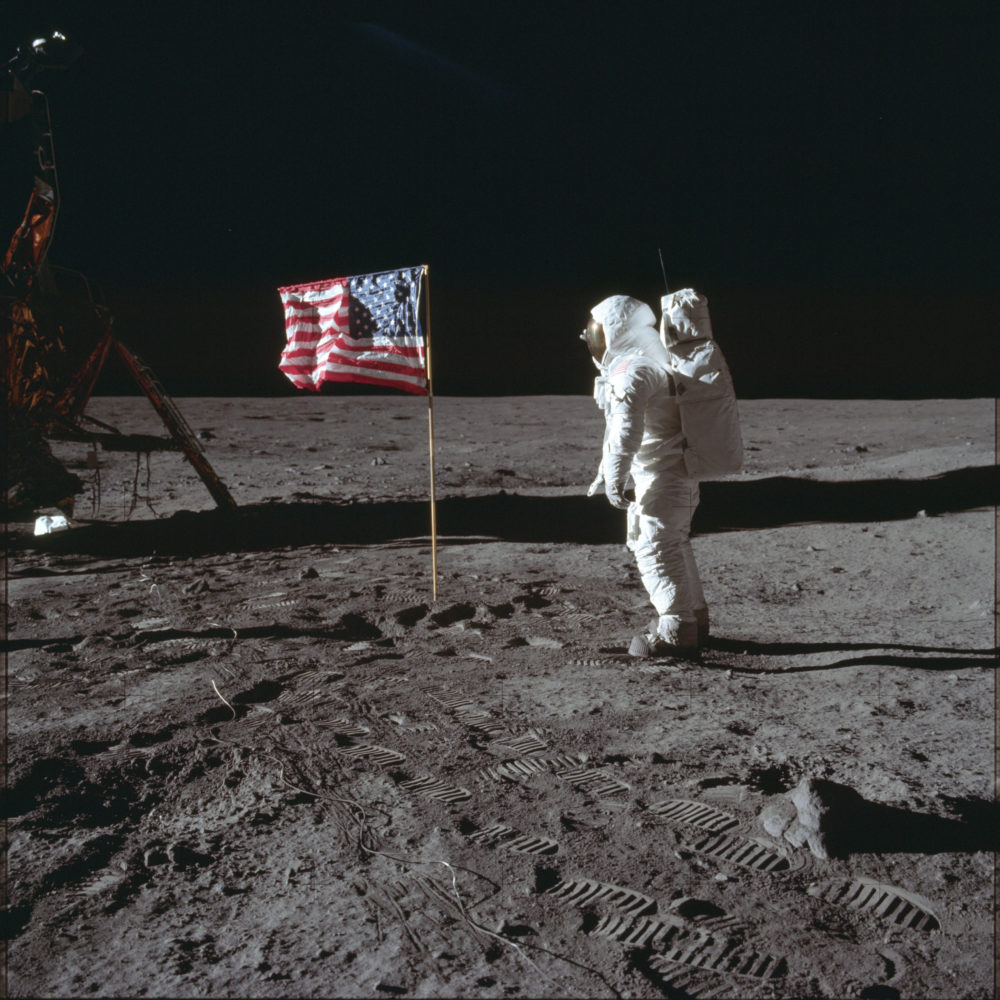 Astronaut Buzz Aldrin poses for a photo beside the U.S. flag on the moon. (Neil Armstrong/NASA via AP)
