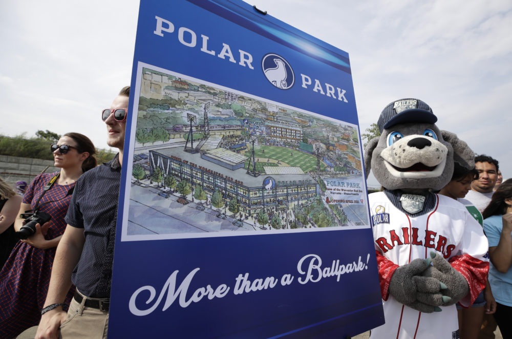 Spectators watch near an artist's rendering during a groundbreaking ceremony for a new minor league baseball stadium, July 11, 2019, in Worcester. Polar Park will be the new home of the Boston Red Sox' Triple-A affiliate, beginning in 2021. (Elise Amendola/AP)