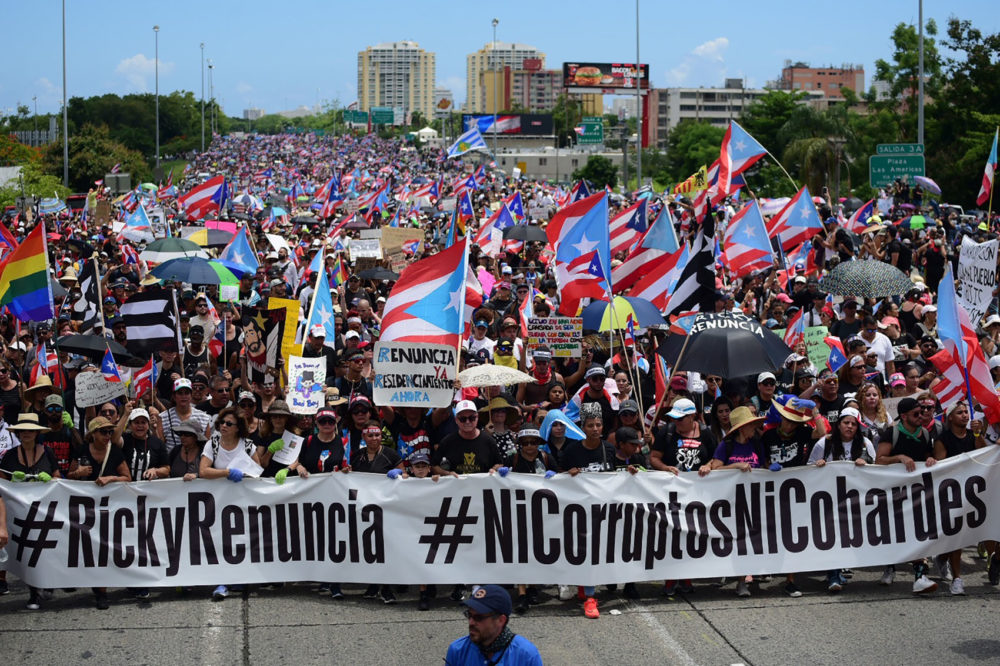 Thousands of Puerto Ricans gather for what many are expecting to be one of the biggest protests ever seen in the U.S. territory, with irate islanders pledging to drive Gov. Ricardo Rossello from office, in San Juan, Puerto Rico, Monday, July 22, 2019. (Carlos Giusti/AP)