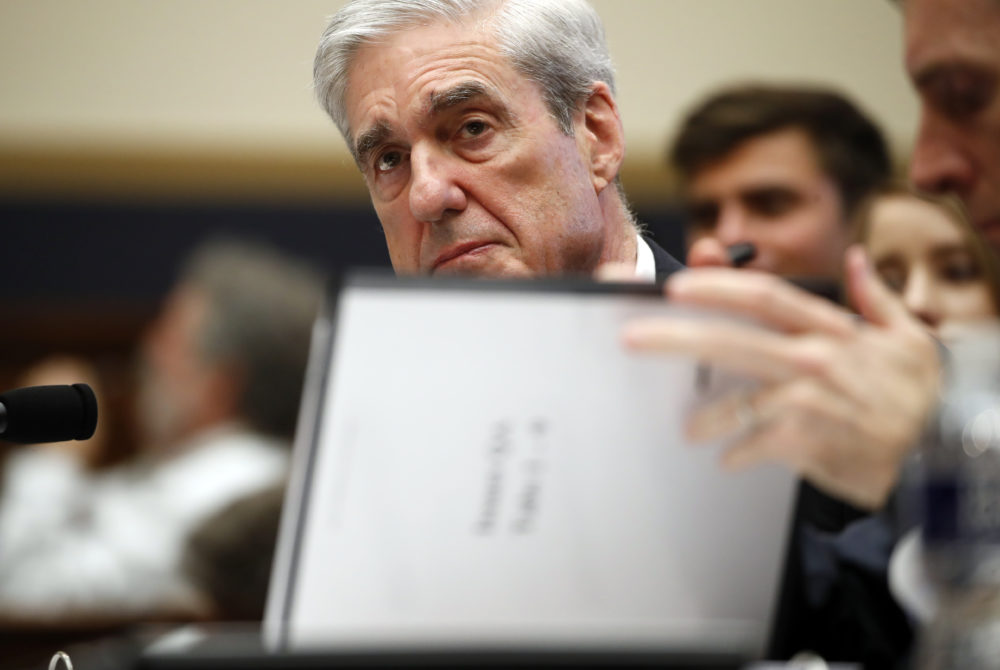 Former special counsel Robert Mueller checks pages in the report as he testifies before the House Judiciary Committee on Wednesday, July 24, 2019 in Washington. (Alex Brandon/AP)