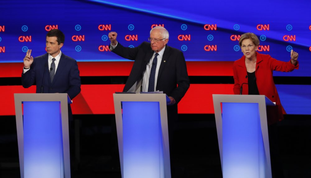 South Bend Mayor Pete Buttigieg, left, and Sen. Elizabeth Warren, seen here in Tuesday's Democratic debate, topped the fundraising list in Massachusetts last quarter. (Paul Sancya/AP)