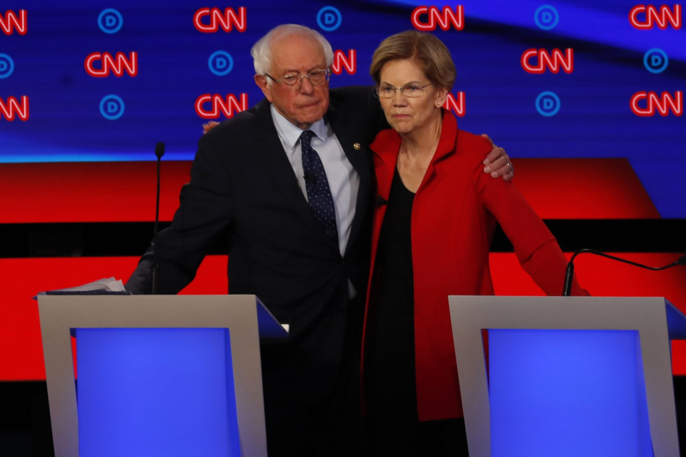 Sen. Bernie Sanders, I-Vt., and Sen. Elizabeth Warren, D-Mass., embrace after the first of two Democratic presidential primary debates hosted by CNN on July 30 in Detroit. (Paul Sancya/AP)