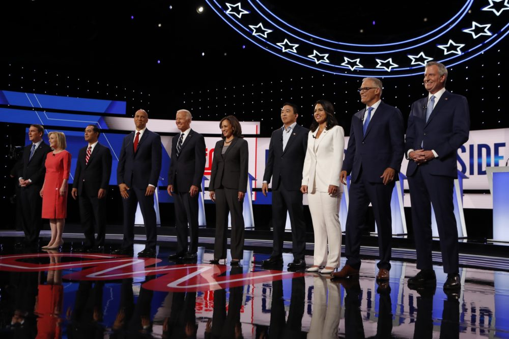 From left, Sen. Michael Bennet, D-Colo., Sen. Kirsten Gillibrand, D-N.Y., former Housing and Urban Development Secretary Julian Castro, Sen. Cory Booker, D-N.J., former Vice President Joe Biden, Sen. Kamala Harris, D-Calif., Andrew Yang, Rep. Tulsi Gabbard, D-Hawaii, Washington Gov. Jay Inslee and New York City Mayor Bill de Blasio are introduced before the second of two Democratic presidential primary debates hosted by CNN Wednesday, July 31, 2019, in the Fox Theatre in Detroit. (Carlos Osorio/AP)