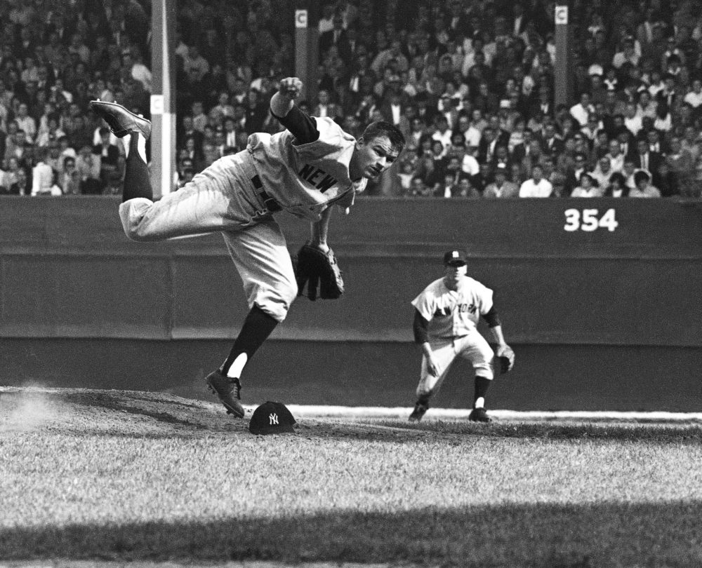 Yankee pitcher Jim Bouton loses his cap pitching against the Cardinals in game 3 of the World Series at Yankee Stadium in New York on Oct. 10, 1964. (AP)