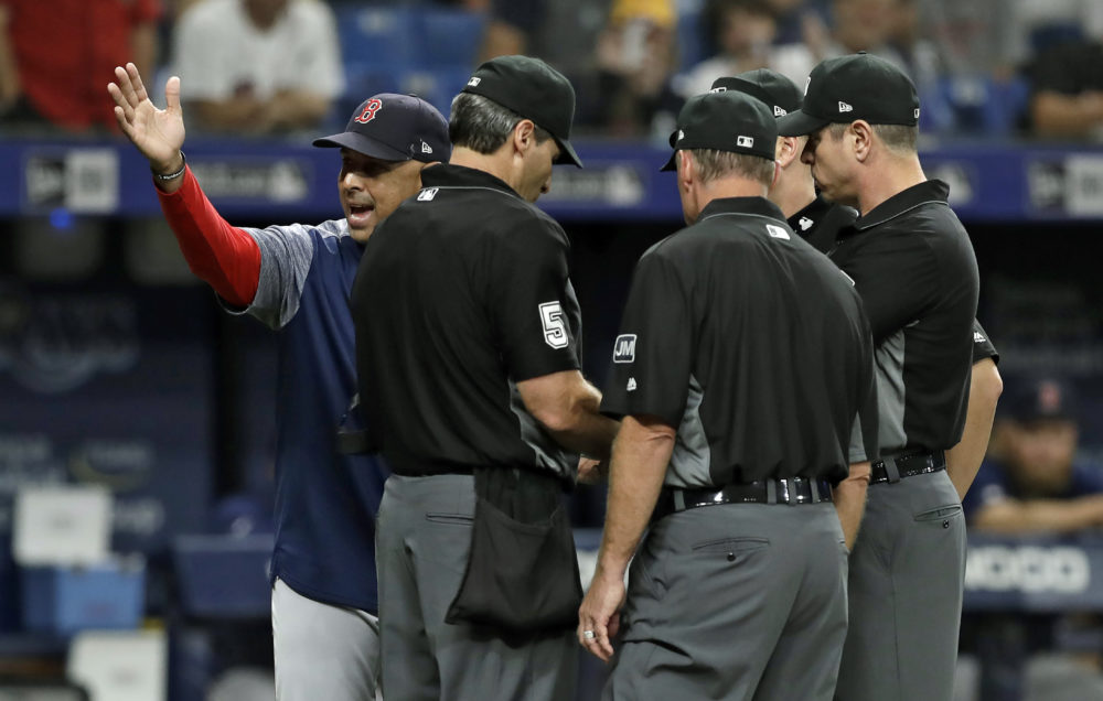 Boston Red Sox manager Alex Cora yells at umps during the eighth inning of a Red Sox-Rays game on July 24.  (Chris O'Meara/AP)