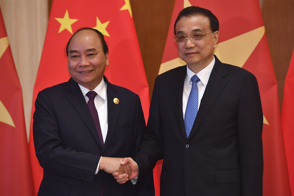 Vietnam's Prime Minister Nguyen Xuan Phuc, left, shakes hands with Chinese Premier Li Keqiang as they pose for media before their meeting on April 26, 2019 in Beijing, China. (Parker Song/Getty Images)