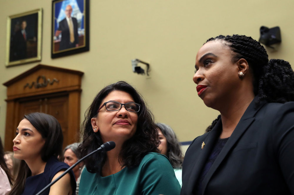 "(Left to right) U.S. Rep. Alexandria Ocasio-Cortez, D-N.Y., Rep. Rashida Tlaib, D-Minn., and Rep. Ayanna S. Pressley, D-Mass., attend a House Oversight and Reform Committee hearing on ""The Trump Administration's Child Separation Policy: Substantiated Allegations of Mistreatment,"" July 12, 2019. (Win McNamee/Getty Images)"