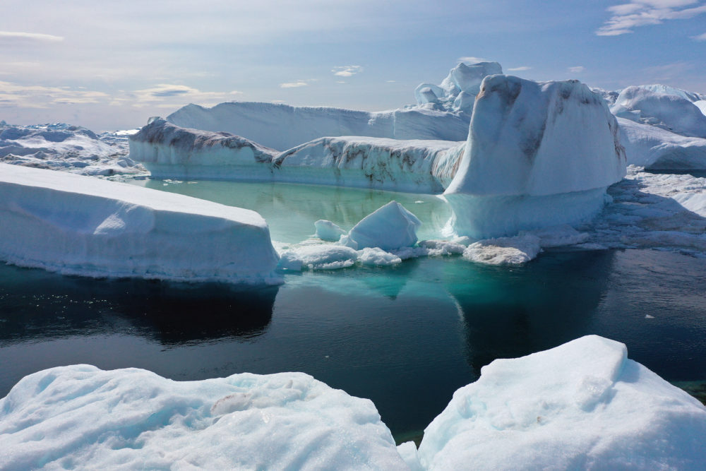 Climate change is having a profound effect in Greenland, where over the last several decades summers have become longer and the rate that glaciers and the Greenland ice cap are retreating has accelerated. (Sean Gallup/Getty Images)