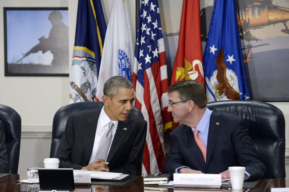 President Barack Obama (left) and U.S. Defense Secretary Ash Carter talk during a national security council meeting on the counter-ISIL campaign at the Pentagon Dec. 14, 2015 in Arlington, Va. (Olivier Douliery-Pool/Getty Images)