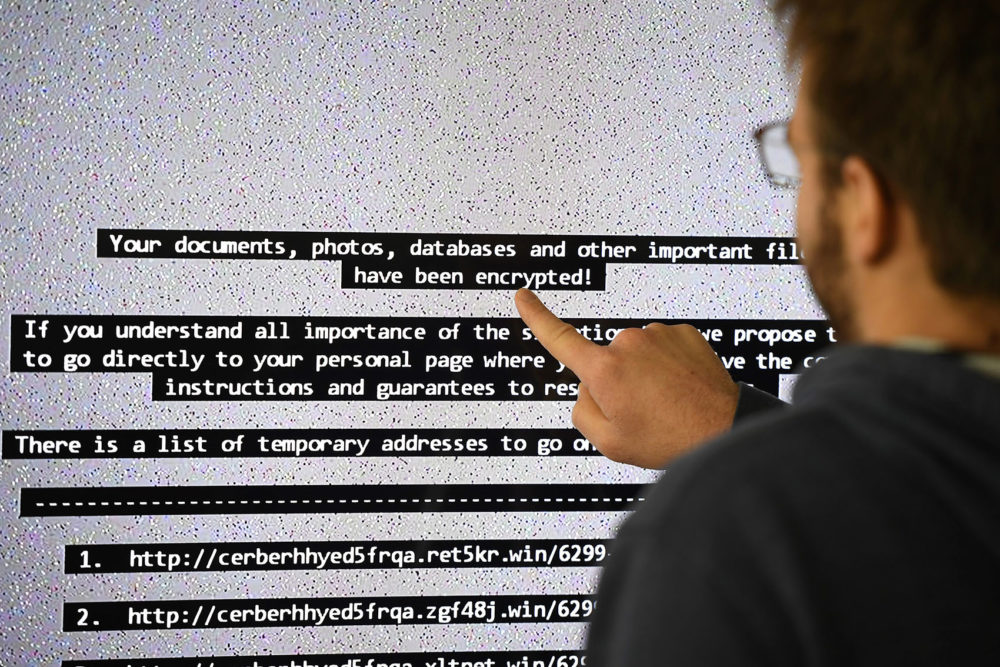 An IT researcher shows on a giant screen a computer infected by a ransomware in Rennes, France on Nov. 3, 2016. (Damien Meyer/AFP/Getty Images)