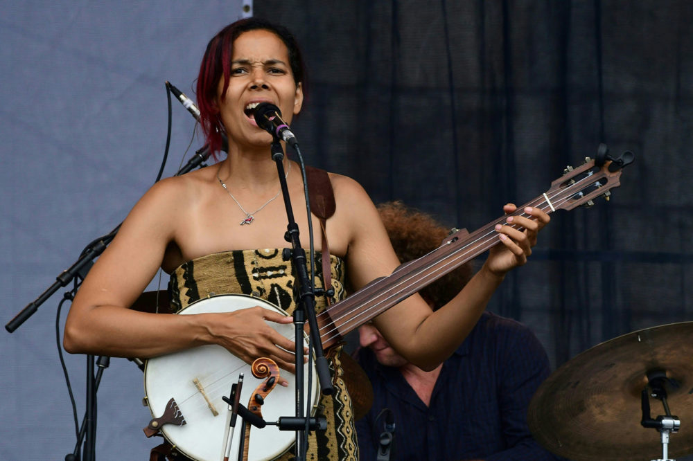 Vocalist Rhiannon Giddens performs with Dirk Powell, Hubby Jenkins, Jason Sypher and Jamie Dick at the Newport Jazz Festival, August 5, 2017 in Newport, R.I. (Eva Hambach/AFP/Getty Images)