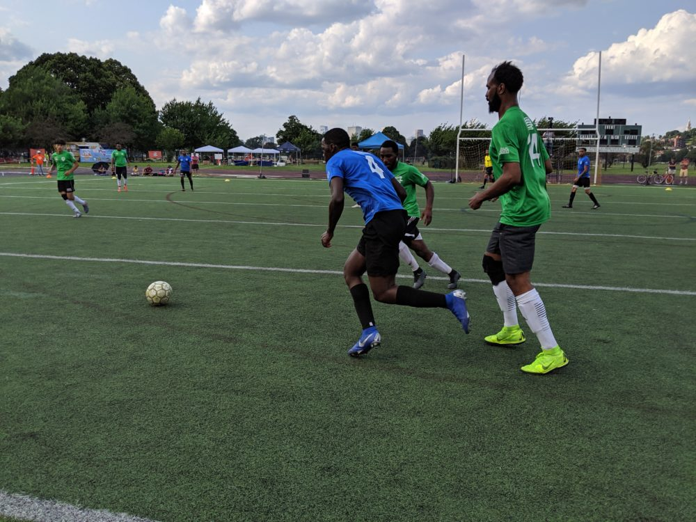 The Boston Unity Cup brings together local players that represent more than 20 countries. Here, the Cape Verde and Sudan (green) teams fight for the ball in the men's final. (Courtesy of Boston Unity Cup)