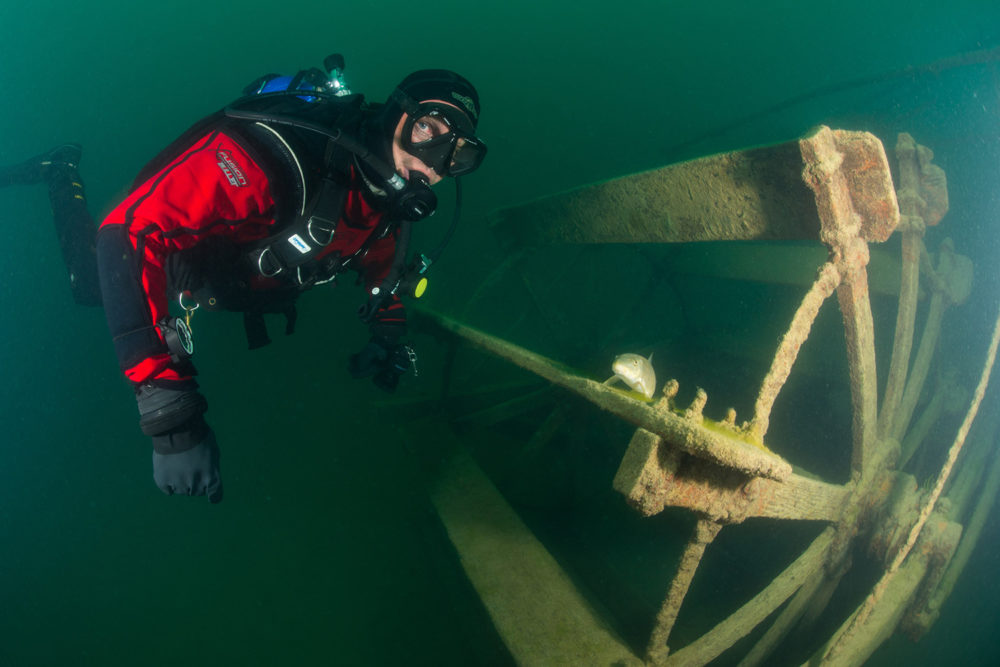 Bill Streever dives near a paddle wheel in Canada. (Photo courtesy of Little, Brown and Company).
