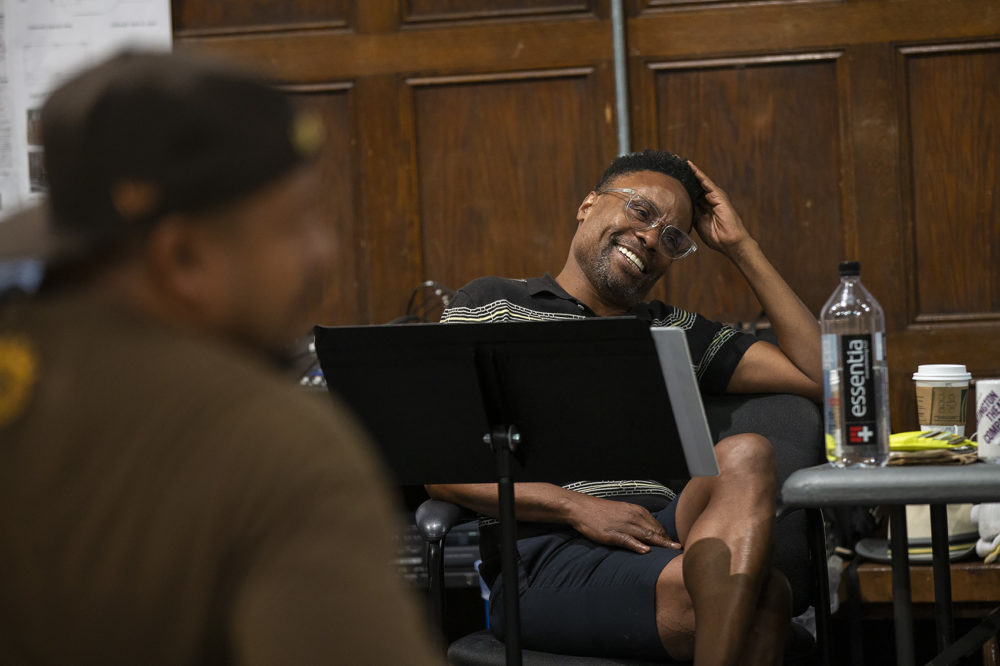 "Director Billy Porter laughs during a rehearsal of the opening scene of ""The Purists"" at the Huntington Theater. (Jesse Costa/WBUR)"