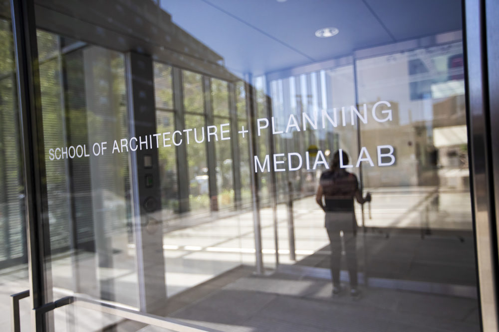 A woman walks through the entrance of the MIT Media Lab. (Jesse Costa/WBUR)