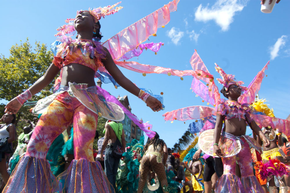 In this file photo, participants in the Cambridge Carnival festival march and dance in 2013. (Greg Cook for WBUR)