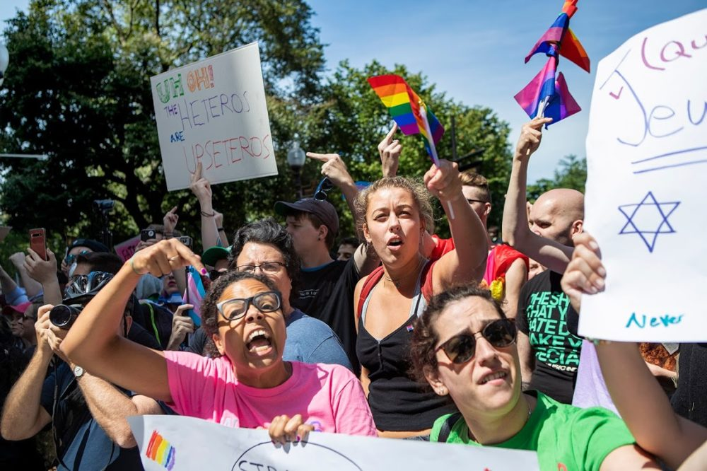 Counter protesters scream at parade participants as the pass by the Boston Common. (Jesse Costa/WBUR)