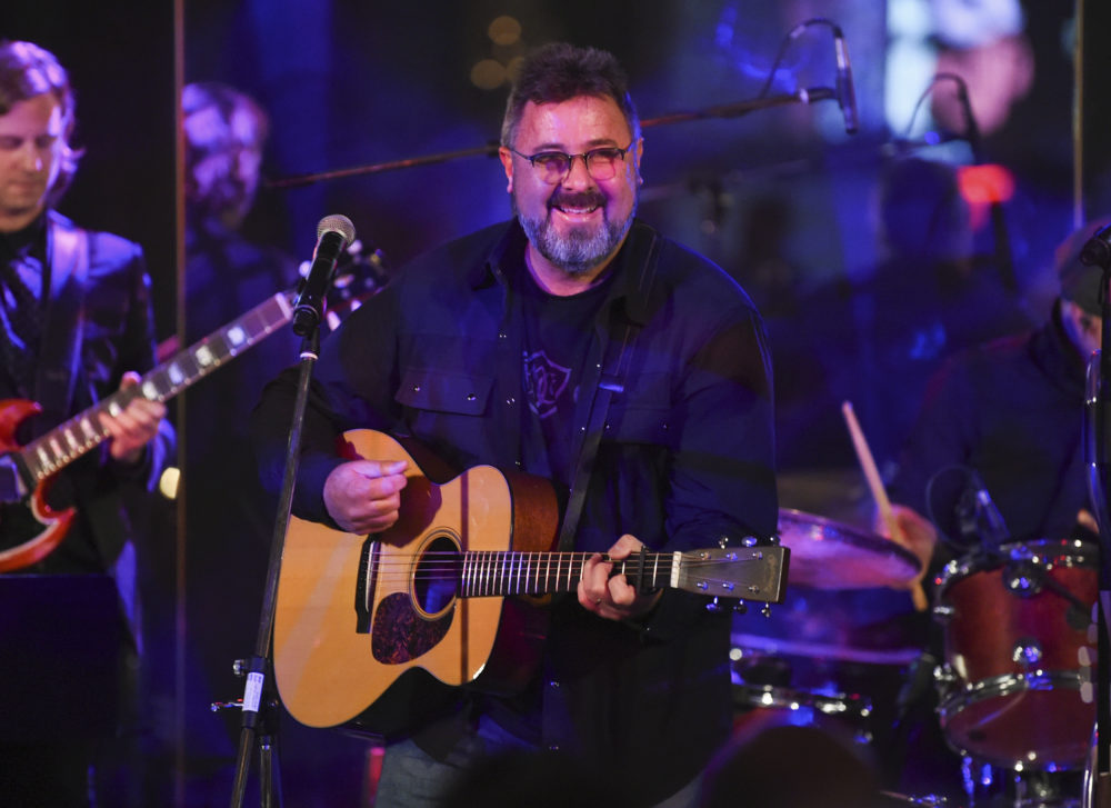 Musician Vince Gill performs at the Facing Addiction with NCADD gala at the Rainbow Room on Monday, Oct. 8, 2018, in New York. (Evan Agostini/Invision/AP)