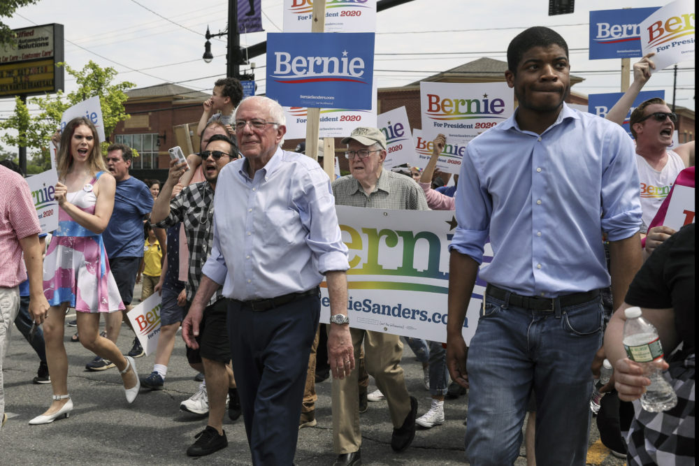 Democratic presidential candidate Sen. Bernie Sanders walks with supporters in the Nashua Pride Parade in Nashua, N.H. on June 29, 2019. (Cheryl Senter/AP)
