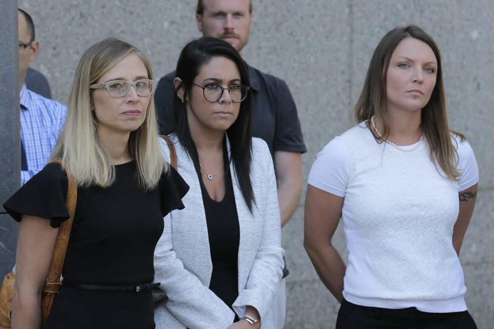 Annie Farmer, left, and Courtney Wild, right, accusers of Jeffery Epstein, stand outside the courthouse in New York, Monday, July 15, 2019. (Seth Wenig/AP)