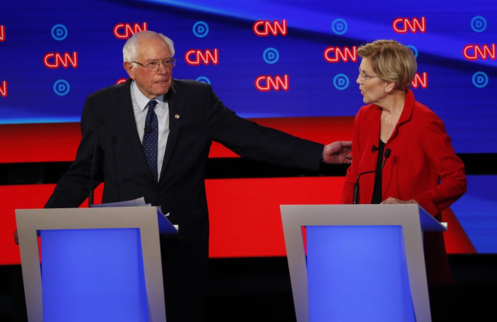 Sen. Bernie Sanders gestures toward Sen. Elizabeth Warren during a Democratic presidential debate on July 30 in Detroit. (Paul Sancya/AP)