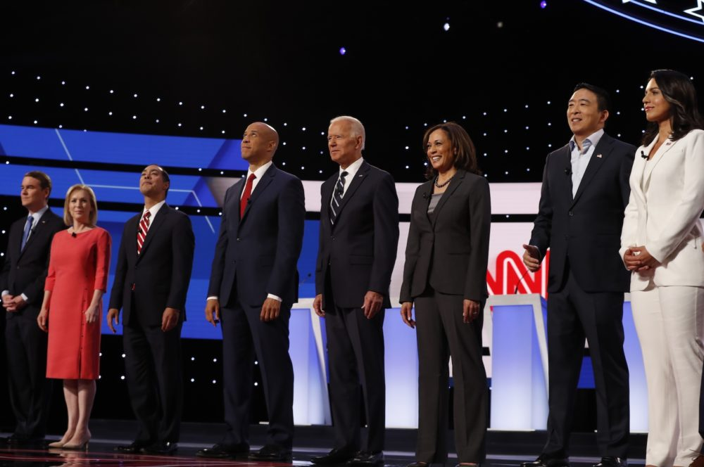 From left, Sen. Michael Bennet, D-Colo., Sen. Kirsten Gillibrand, D-N.Y., former HUD Secretary Julian Castro, Sen. Cory Booker, D-N.J., former Vice President Joe Biden, Sen. Kamala Harris, D-Calif., Andrew Yang and Rep. Tulsi Gabbard, D-Hawaii, are introduced before the second of two Democratic presidential primary debates hosted by CNN Wednesday, July 31, 2019, in the Fox Theatre in Detroit. (Carlos Osorio/AP)