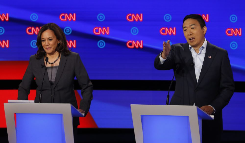 Sen. Kamala Harris, D-Calif., listens as Andrew Yang speaks during the second of two Democratic presidential primary debates hosted by CNN Wednesday, July 31, 2019, in the Fox Theatre in Detroit. (Paul Sancya/AP)