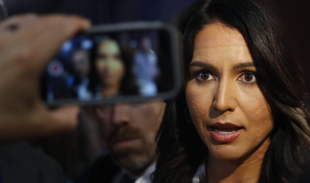 Rep. Tulsi Gabbard, D-Hawaii, answers questions after the second of two Democratic presidential primary debates hosted by CNN Thursday, Aug. 1, 2019, in the Fox Theatre in Detroit. (Paul Sancya/AP)