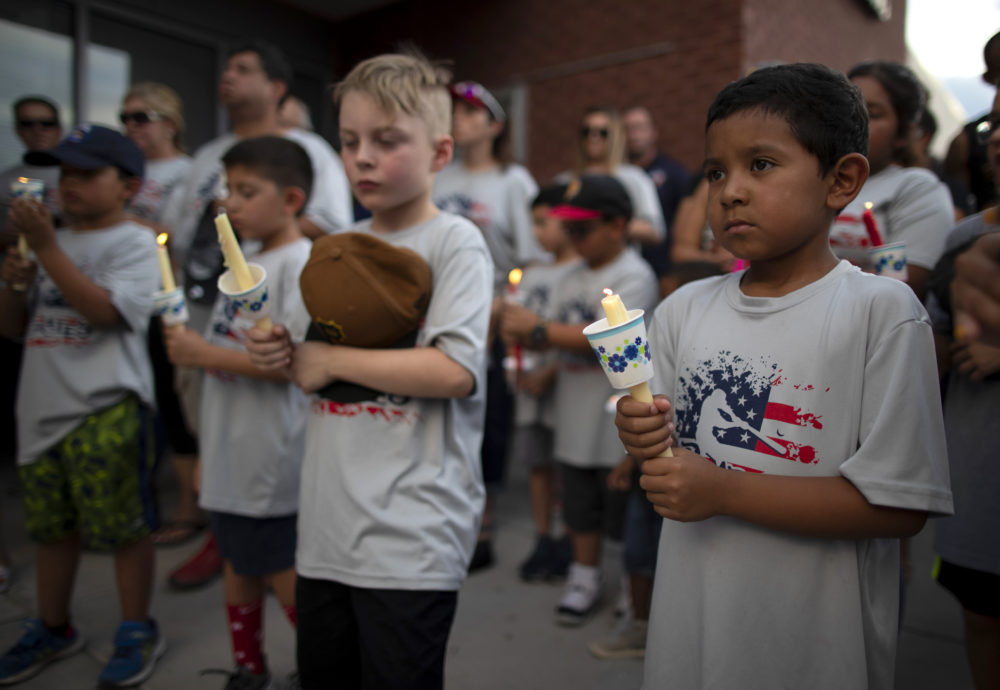 Children of a youth sports community participate in a vigil for the victims of Saturday's mass shooting in El Paso, Texas, Sunday, Aug. 4, 2019. (Andres Leighton/AP)