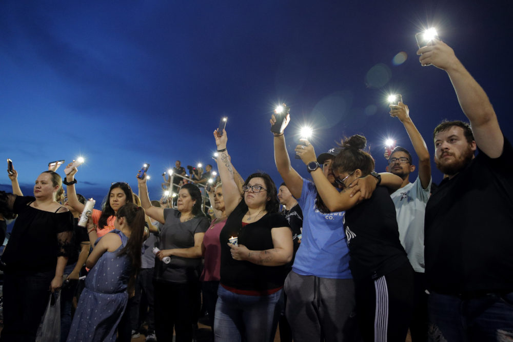 People on Sunday attend a vigil for victims of Saturday's mass shooting at a shopping complex in El Paso, Texas. (John Locher/AP)