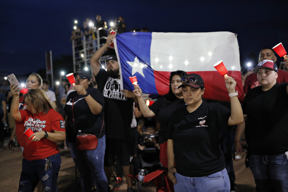 People attend a vigil for victims of Saturday's mass shooting at a shopping complex Sunday, Aug. 4, 2019, in El Paso, Texas. (John Locher/AP)