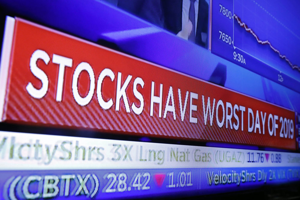 A television screen on the floor of the New York Stock Exchange headlines the day's trading, Monday, Aug. 5, 2019. (Richard Drew/AP)