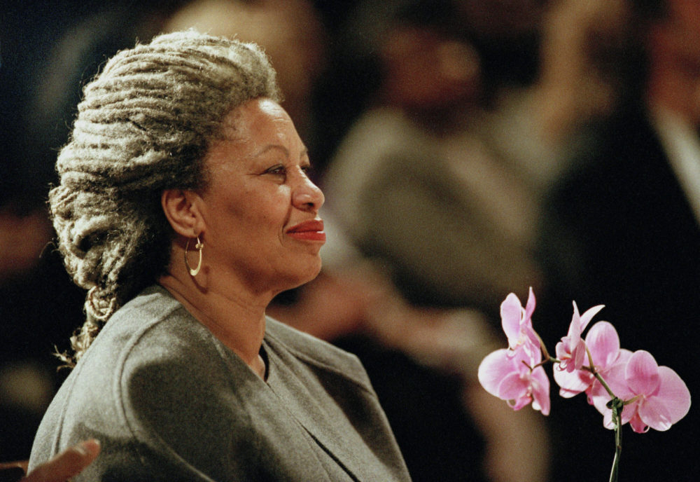 In this April 5, 1994 file photo, Toni Morrison holds an orchid at the Cathedral of St. John the Divine in New York. The Nobel Prize-winning author has died. (Kathy Willens/AP File Photo)