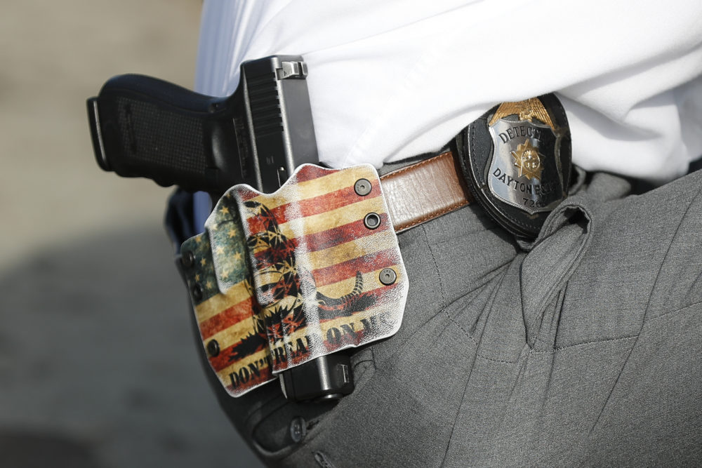 A Dayton Police detective wears his sidearm in a holster on Aug. 6 in Dayton. (John Minchillo/AP)