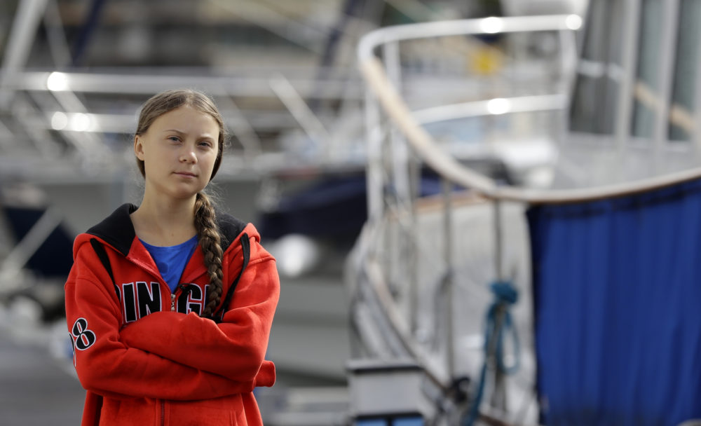 Greta Thunberg walks in the marina where the boat Malizia is moored, in Plymouth, England, on Aug. 13. The 16-year-old activist, who has inspired student protests around the world, sailed to New York in a high-tech but low-comfort boat to raise awareness for climate change. (Kirsty Wigglesworth/AP)