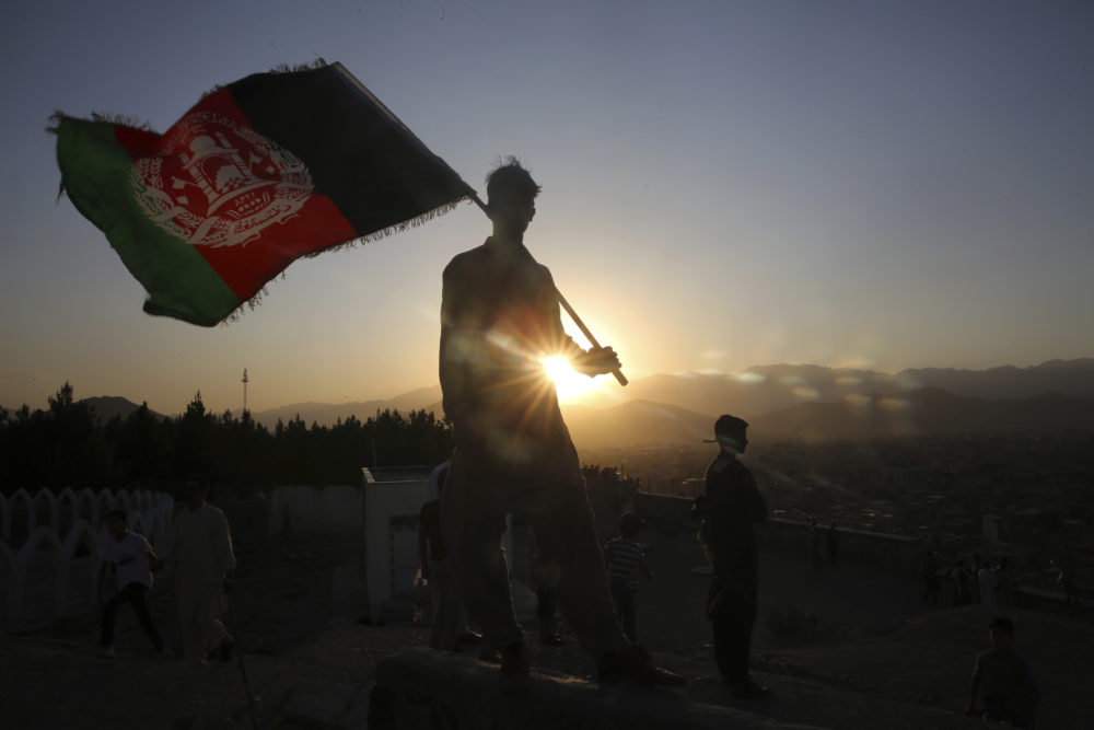 A man waves an Afghan flag during Independence Day events in Kabul, Afghanistan, Monday, Aug. 19, 2019.  (Rafiq Maqbool/AP)