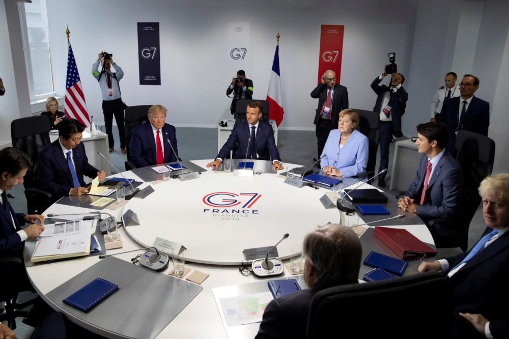 From the left, Italian Prime Minister Giuseppe Conte, Japanese Prime Minister Shinzo Abe, U.S President Donald Trump, French President Emmanuel Macron, German Chancellor Angela Merkel, Canadian Prime Minister Justin Trudeau, Britain's Prime Minister Boris Johnson at the G-7 summit in France on Monday Aug. 26 2019. (Ian Langsdon/Pool via AP)