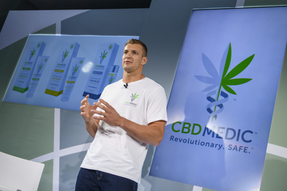 Former New England Patriots tight end Rob Gronkowski holds a news conference announcing his advocacy for CBD and becoming an investor in Abacus Health Products. (AP Photo/Corey Sipkin)