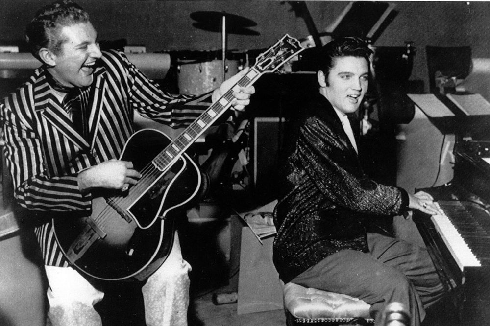 Piano virtuoso Liberace is shown playing the guitar with Elvis Presley at the piano in November 1956 at the Riviera Hotel in Las Vegas. (AP Photo)