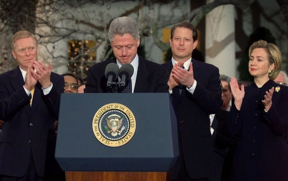 President Clinton receives applause as he makes remarks to Democratic lawmakers after the House of Representatives voted to impeach the president, Saturday Dec. 19, 1998. (Doug Mills/AP)