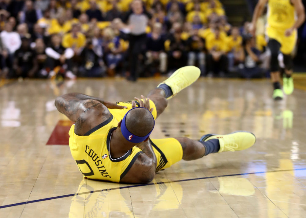 DeMarcus Cousins falls to the ground crowd after tearing his quadriceps on April 15, 2019. (Ezra Shaw/Getty Images)