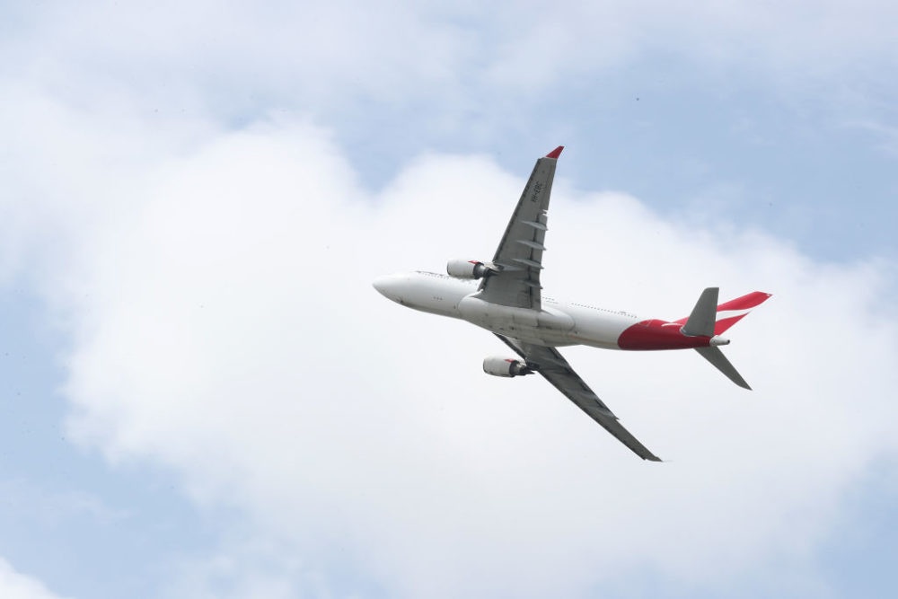 A Qantas commercial plane takes off at Sydney Airport on March 14, 2019 in Sydney, Australia. (Cameron Spencer/Getty Images)