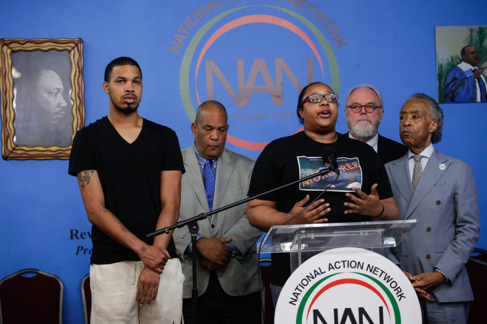 Eric Garner's daughter Emerald Garner and Rev. Al Sharpton (right) speak to the media on August 19, 2019 in New York City. The New York Police Department announced that Officer Daniel Pantaleo has been fired from the force due to his involvement in Eric Garner's death in 2014. (Kena Betancur/Getty Images)
