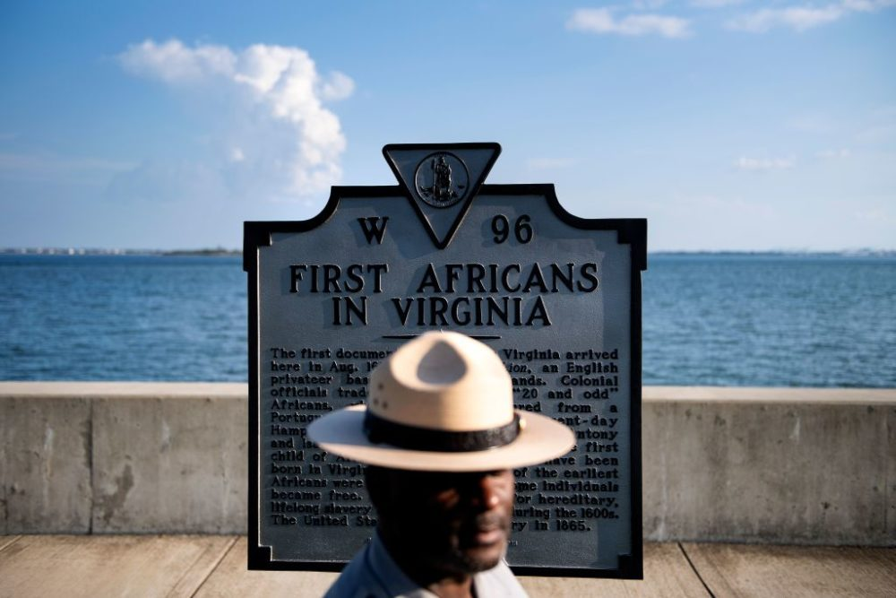 Superintendent of Fort Monroe National Monument, Terry E. Brown, poses near a historical marker at the fort, August 19, 2019, in Hampton, Virginia. (Brendan Smialowski/AFP/Getty Images)