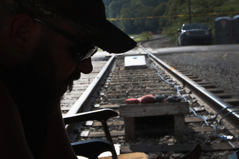 Chris Rowe, an unemployed Blackjewel coal miner, mans a blockade of the railroad tracks that lead to the mine where he once worked on August 24, 2019 in Cumberland, Kentucky. (Scott Olson/Getty Images)