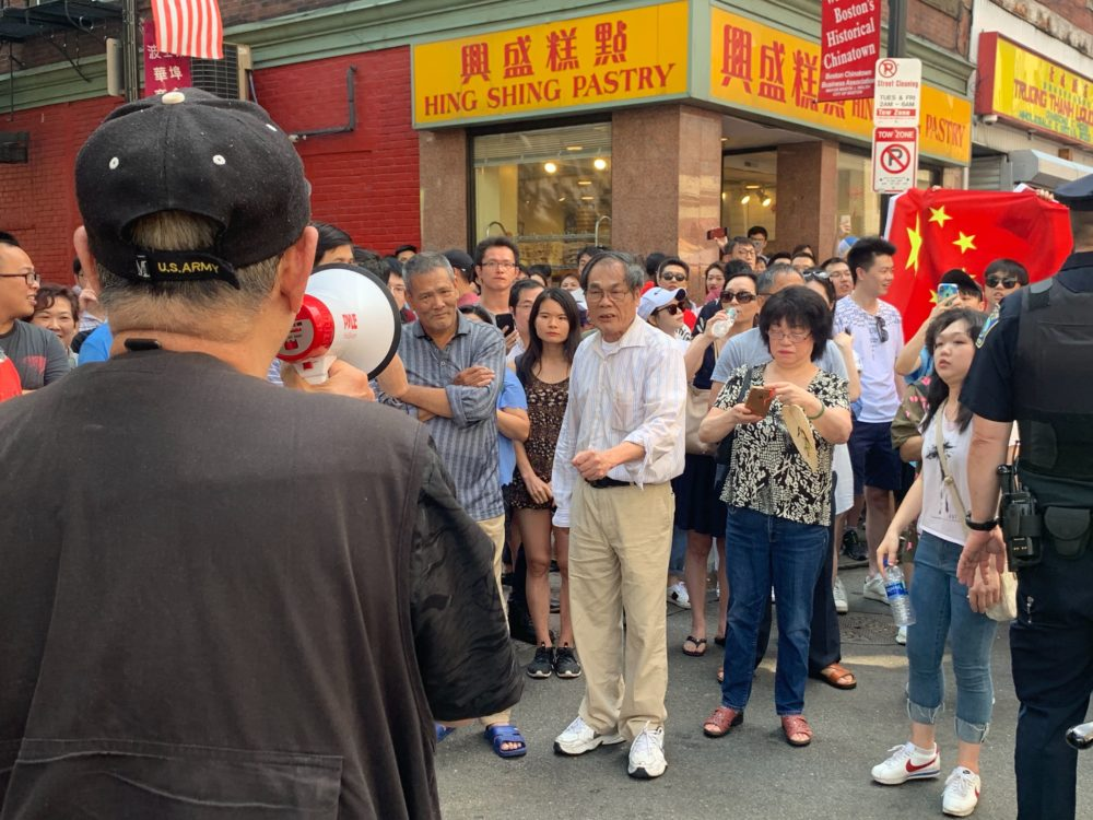 Protesters filled the streets of Boston's Chinatown to show solidarity with Hong Kong on Sunday, but a counterprotest became large, causing tensions to flare between the two sides. (Simón Rios/WBUR)