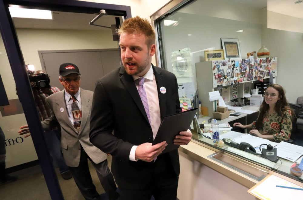 Tommy Hickey, director of the Massachusetts Right to Repair Coalition, walked the first round of paperwork for his group's proposed ballot question into the attorney general's office in August. (Sam Doran/State House News Service)