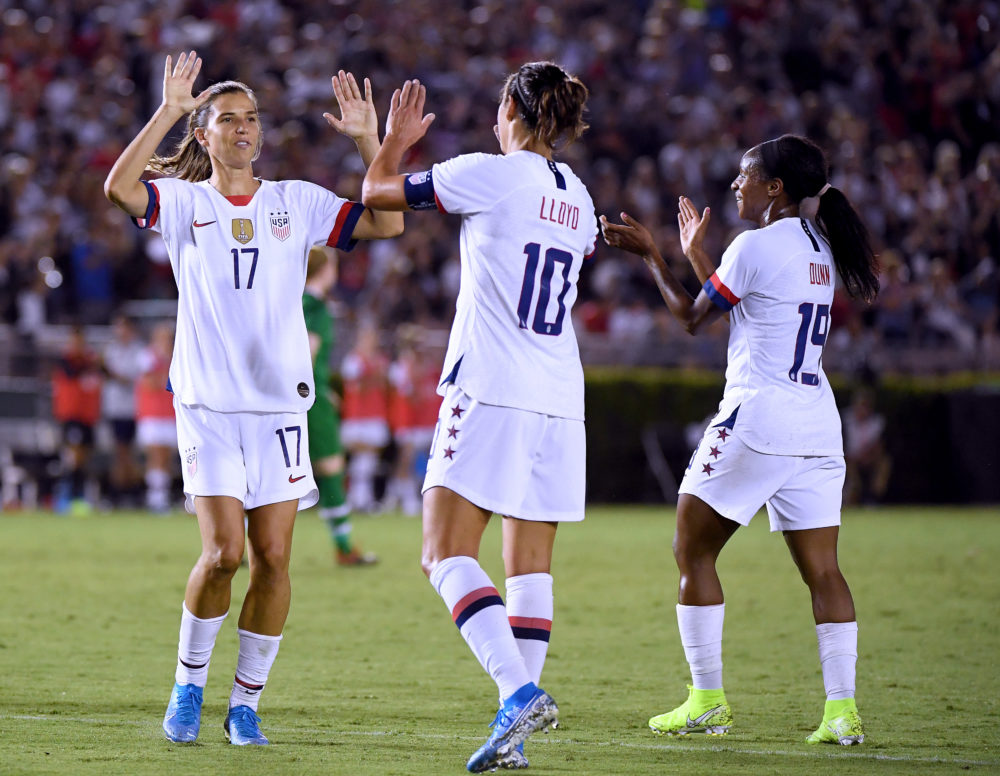 Carli Lloyd celebrates a goal with Tobin Heath  and Crystal Dunn during the first half of the first game of the USWNT Victory Tour on Aug. 03 in Pasadena. (Harry How/Getty Images)