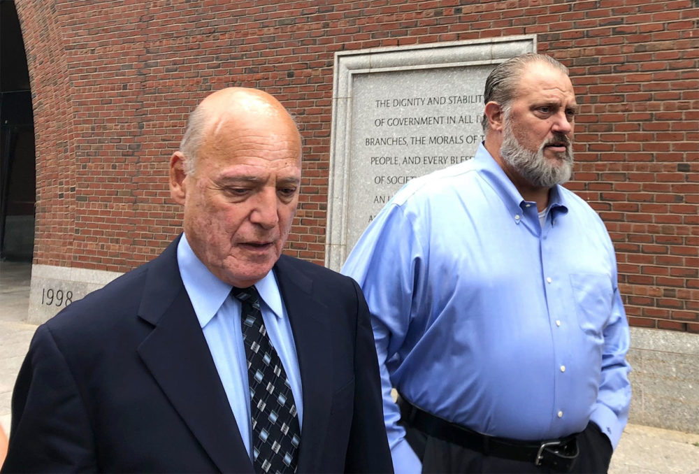 Former state police union chief Dana Pullman, right, leaves federal court in Boston with his lawyer, Martin Weinberg in August. (Chris Lisinski/State House News Service)